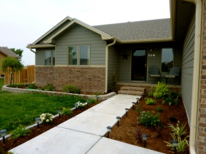 Our house after installing a sprinkler system, building a fence, and doing some landscaping!